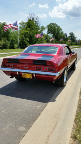 Chevrolet Camaro Coupe 1969 red with Sell black stripes For