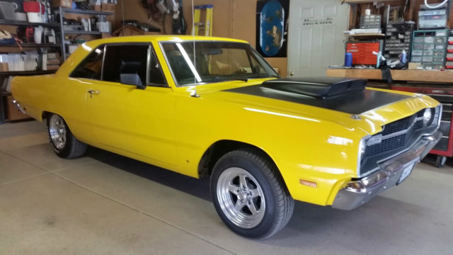 Curiously Yellow 1969 dodge swinger have hit