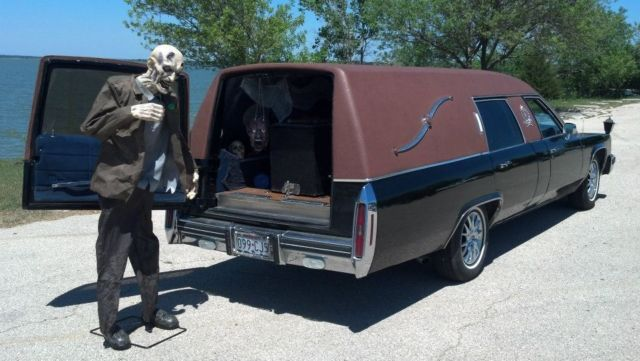 cadillac hearse 1983 metallic green ostrich top for sale
