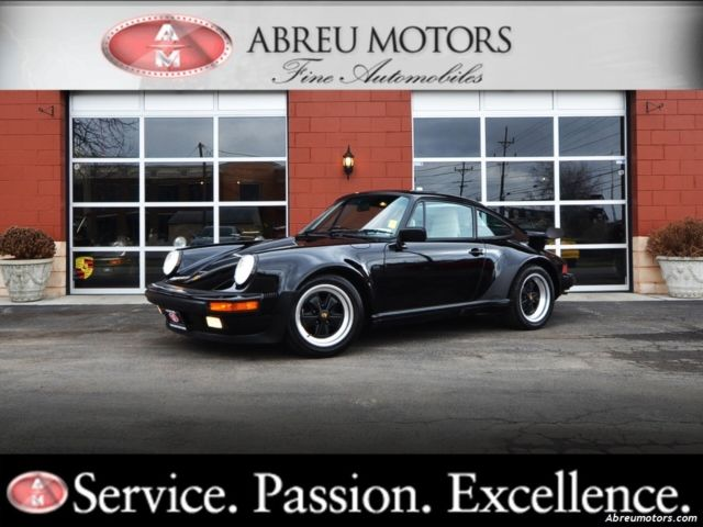 Porsche 930 Coupe 1987 Black For Sale. WP0JB093XHS050223 Only 26,000 miles - Spectacular Condition! Original Window Sticker.